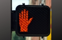 Road sign with red hand
